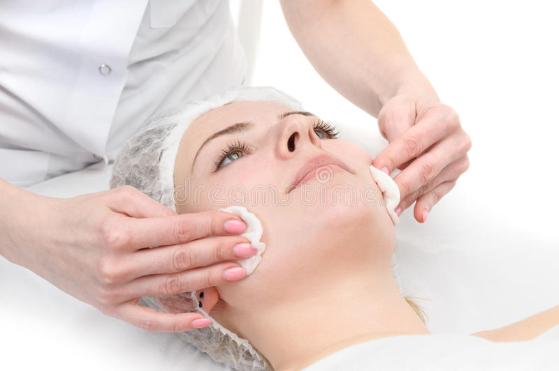 Facial mask wipe. Beauty salon, facial mask wiping, removing with napkins royalty free stock image