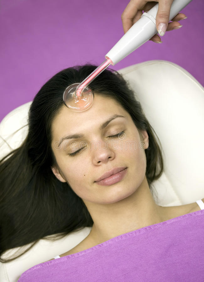 Facial massage in a beauty salon. stock images