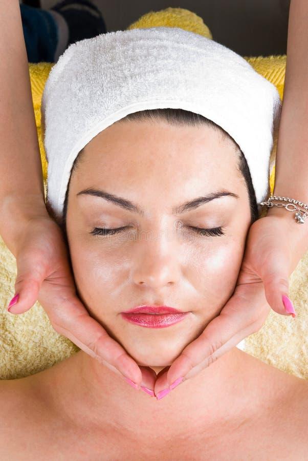 Facial massage at daily spa royalty free stock image