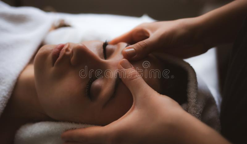 Facial massage at spa stock photo