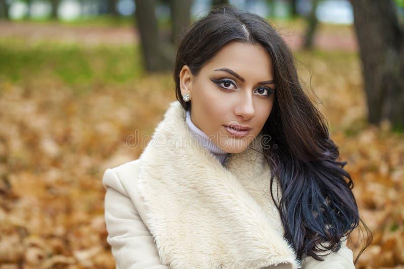 Facial portrait of a beautiful arab woman warmly clothed outdoor. Facial portrait of a beautiful arab woman warmly clothed autumn outdoor stock image