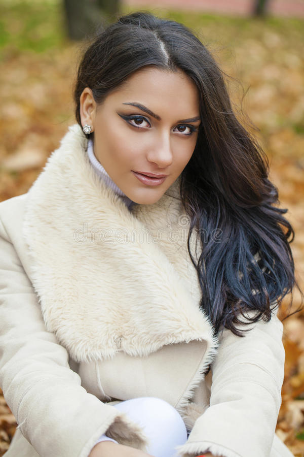 Facial portrait of a beautiful arab woman warmly clothed outdoor. Facial portrait of a beautiful arab woman warmly clothed autumn outdoor royalty free stock images