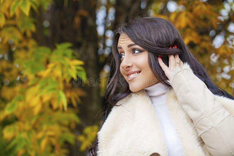 Facial portrait of a beautiful arab woman warmly clothed outdoor. Facial portrait of a beautiful arab woman warmly clothed autumn outdoor royalty free stock photo