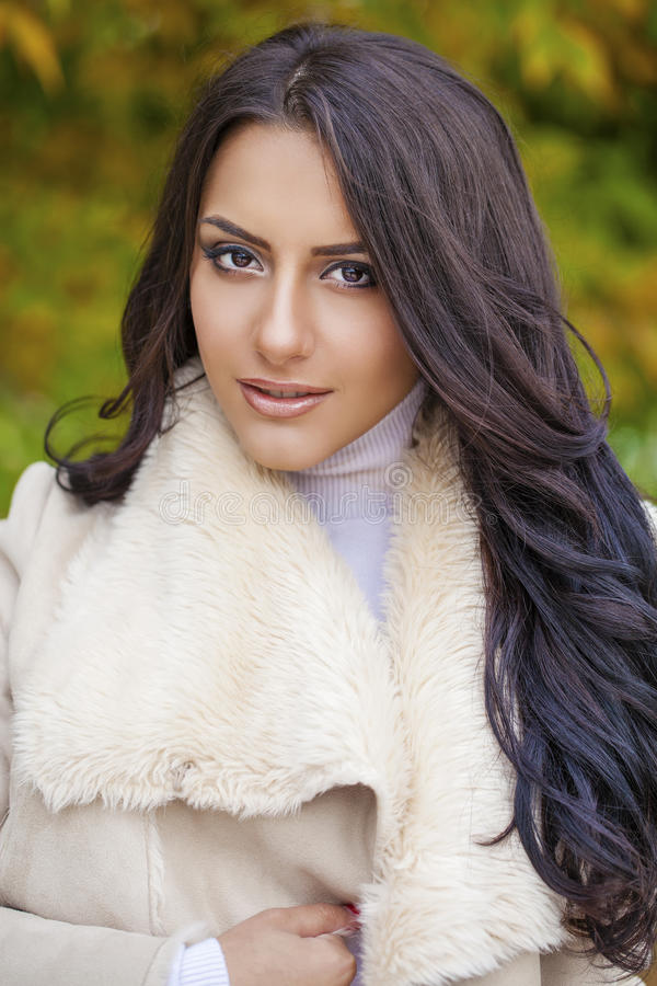 Facial portrait of a beautiful arab woman warmly clothed outdoor. Facial portrait of a beautiful arab woman warmly clothed autumn outdoor royalty free stock photography