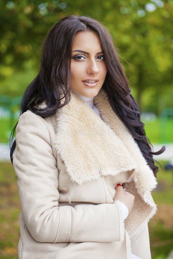Facial portrait of a beautiful arab woman warmly clothed outdoor. Facial portrait of a beautiful arab woman warmly clothed autumn outdoor royalty free stock photos