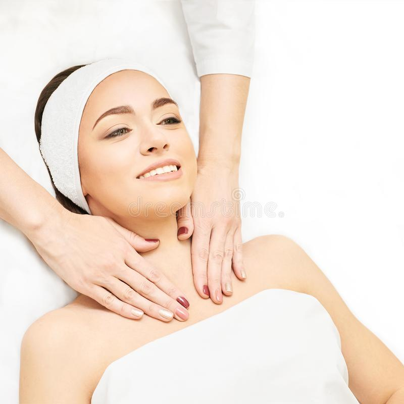 Facial salon massage. Woman professional therapy. Hands at neck. Healthy cosmetic procedure. Luxury spa treatment royalty free stock photo