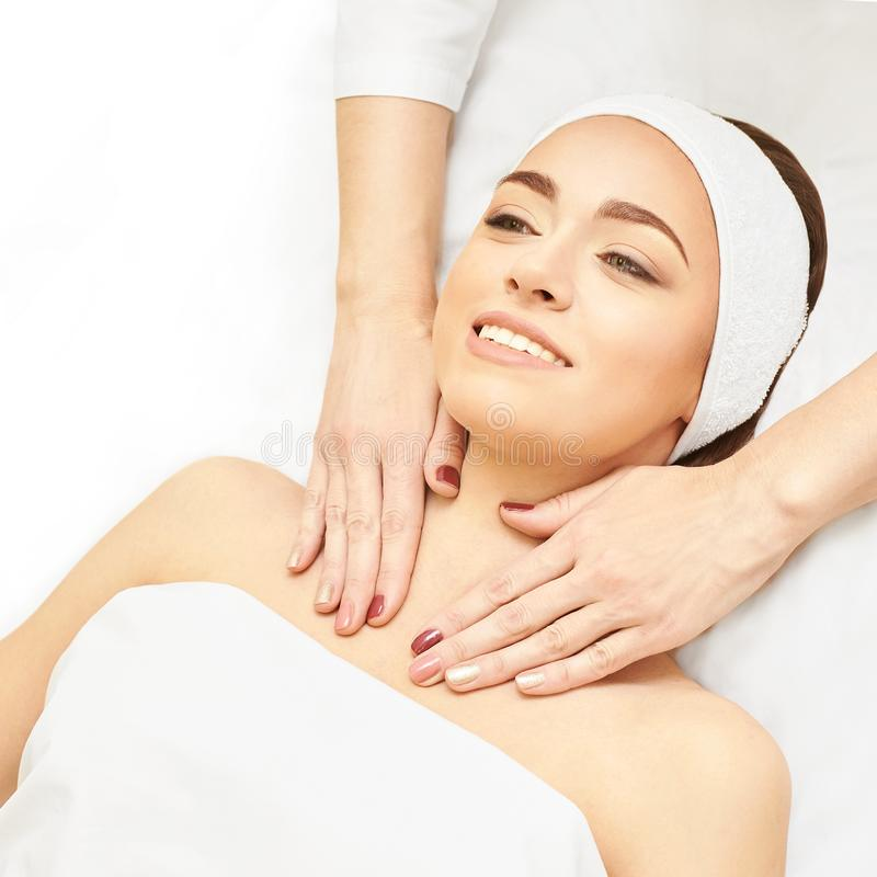 Facial salon massage. Woman professional therapy. Hands at neck. Healthy cosmetic procedure. Luxury spa treatment royalty free stock photos