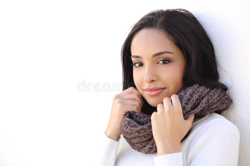 Facial of a woman smooth face in winter. Warmly clothed outdoors royalty free stock photo
