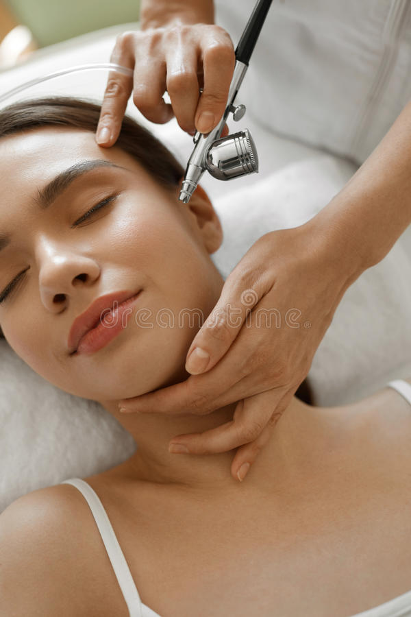 Facial Skincare. Woman Receiving Oxygen Peeling Beauty Treatment stock photos