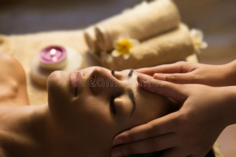 Facial SPA massage. Beautiful woman getting spa treatment. Facial massage