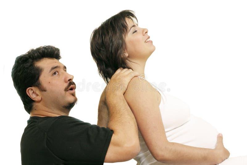 Facilitando a dor traseira foto de stock