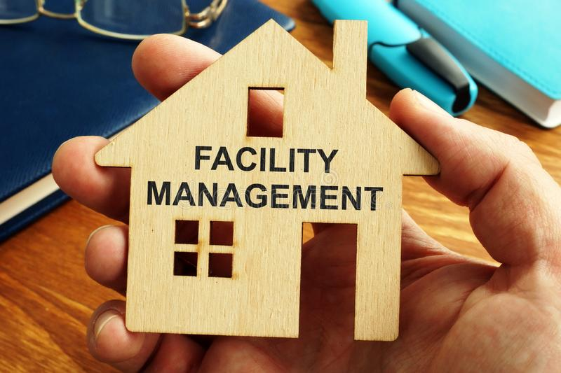 Facility management written on the small house royalty free stock images