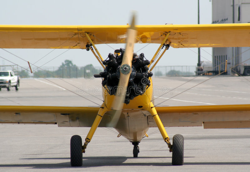 Facing a Biplane. A biplane coming directly at the shooter royalty free stock photography