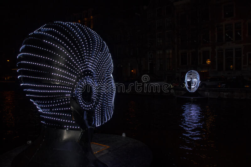 Facing heads over the canal at Amsterdam royalty free stock photo