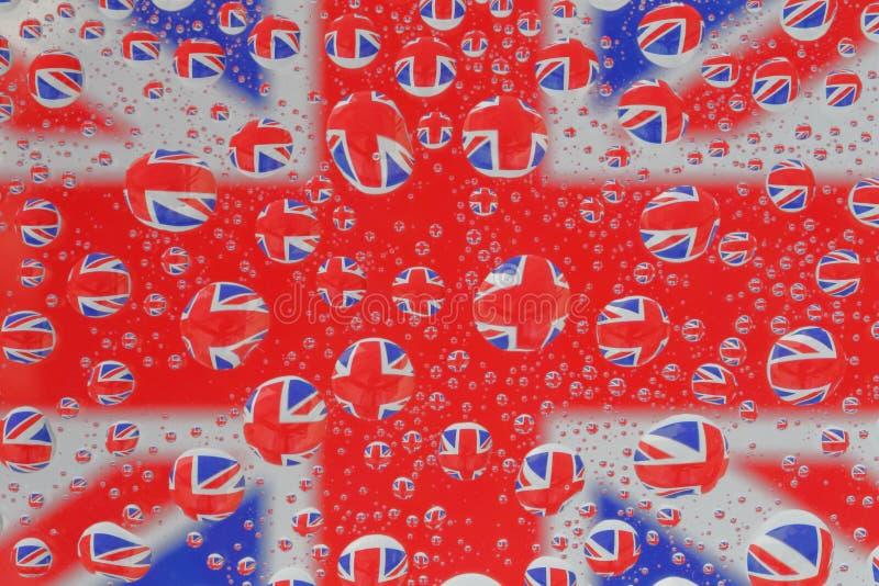 Fackliga Jack Flag till och med vattensmå droppar arkivfoton