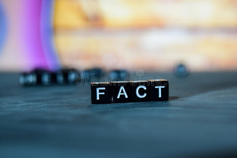 Fact on wooden blocks. Cross processed image with bokeh background stock image