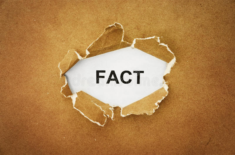Fact. The word fact in the hole of brown paper royalty free stock photography