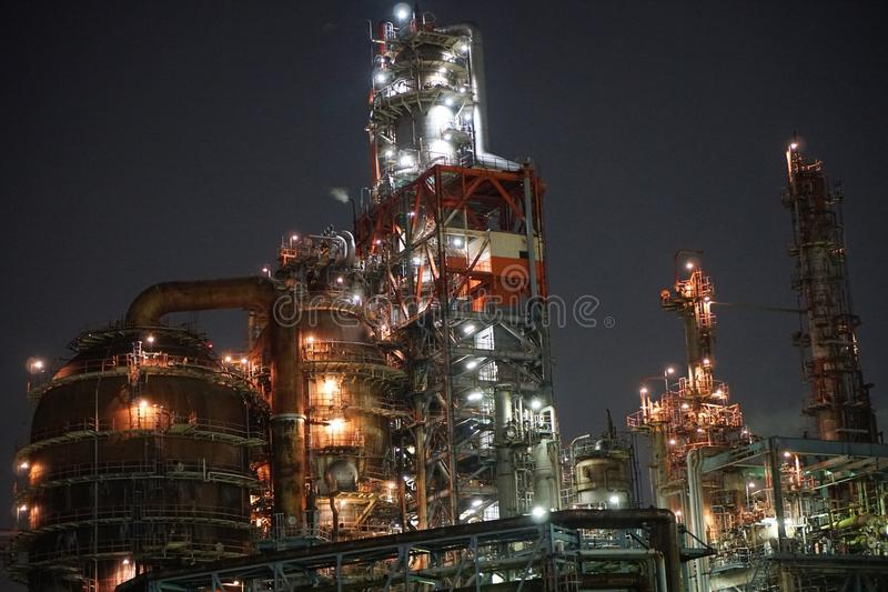 Factories view from a canal at night in Kawasaki, Tokyo royalty free stock image