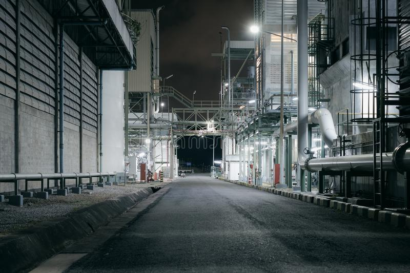 Factory. Building and road of industrial plant at night royalty free stock photo