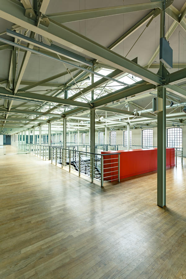 Factory building with steel construction. Modern factory building with steel construction and wood floor stock image