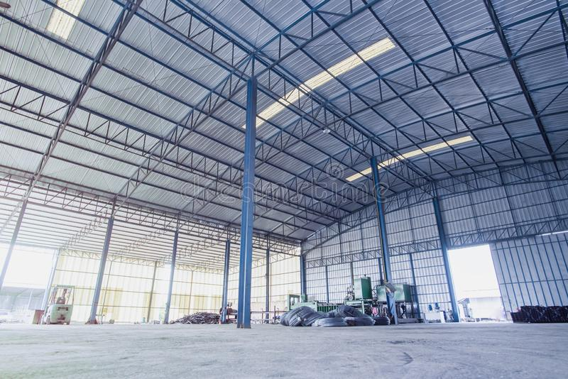 Factory building or warehouse building with concrete floor for background. An interior of an empty warehouse.Internal factory buildings stock images