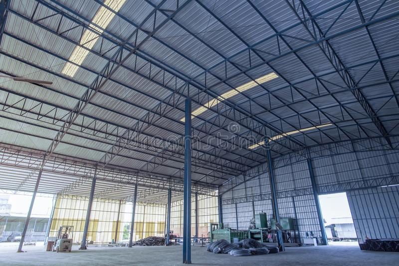 Factory building or warehouse building with concrete floor for background. An interior of an empty warehouse.Internal factory buildings stock photo