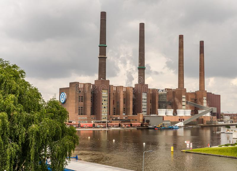 The factory of the car manufacturer VW Volkswagen in Wolfsburg, Germany, June 15, 2018, with the four chimneys at the harbour stock image