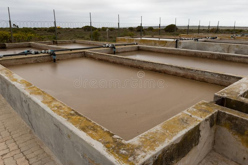 Factory chemical waste reservoir with sludge royalty free stock images