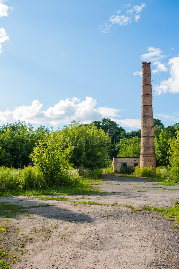 Factory chimney. Old crumbling pipe made of bricks. Steadicam shot stock photography