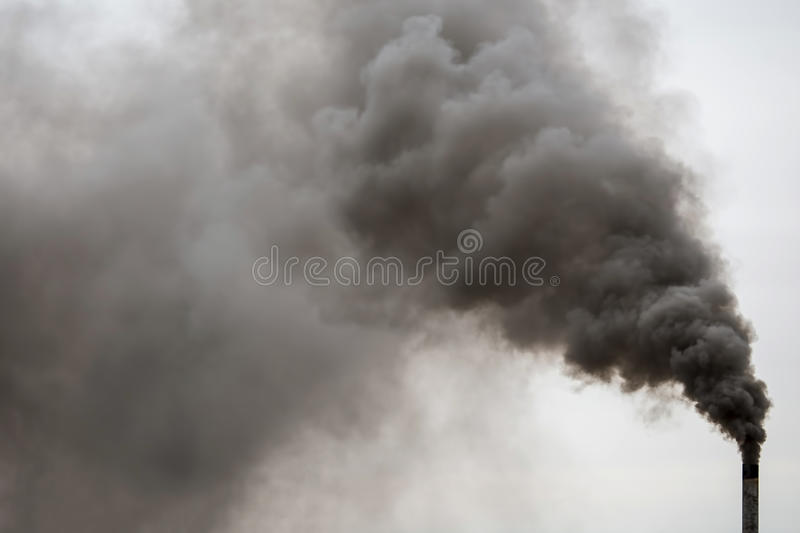 Factory chimney smoking, heavy black smoke on the sky. royalty free stock photos