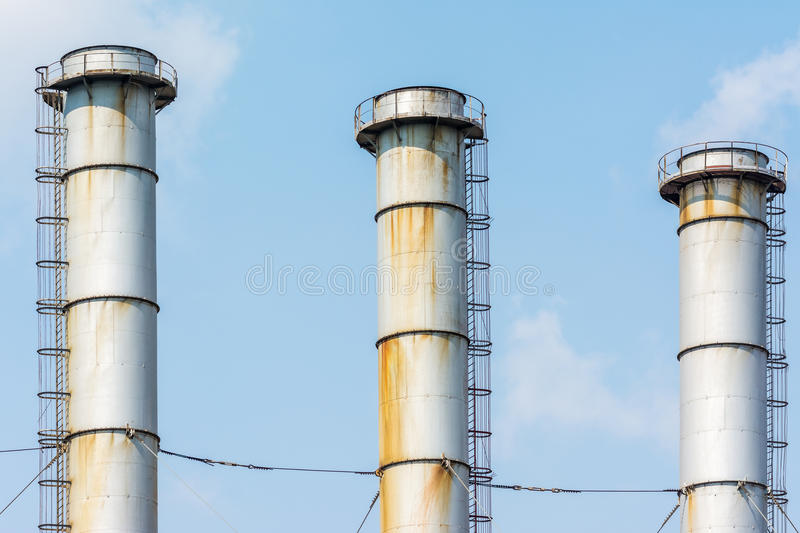 Factory Chimneys Of Coal Power Plant. Against Blue Sky royalty free stock photography