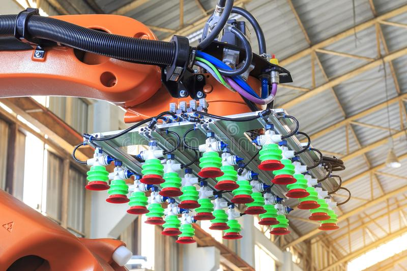 Factory 4.0 concept, Picking vacuum pad on industrial robot arm for smart warehouse in manufacturing factory, royalty free stock photos