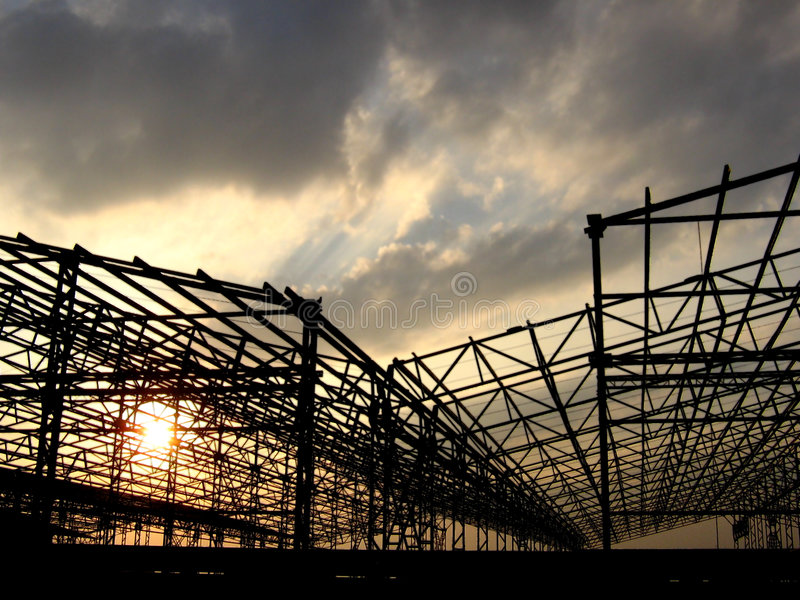 Factory Construction. The construction framework of the large sheds of a factory stock image