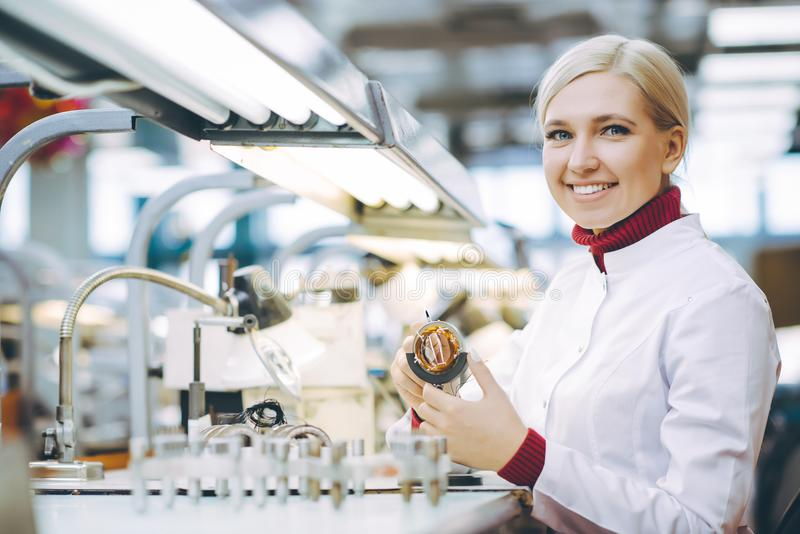 Factory electronics worker stock photo