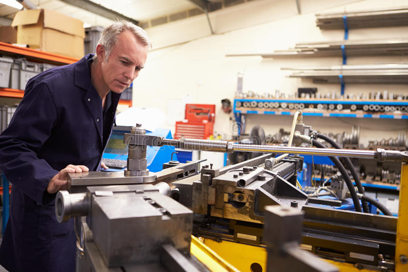 Factory Engineer Operating Hydraulic Tube Bender royalty free stock images