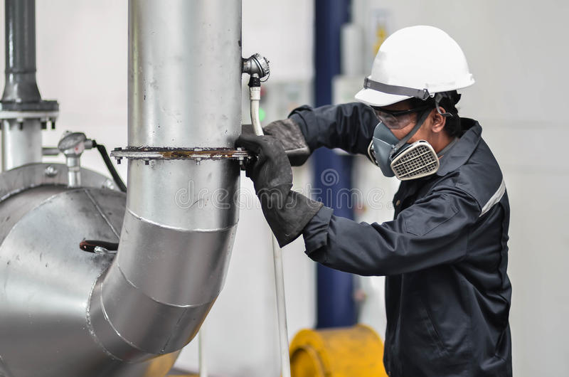 Factory Engineer Operating Hydraulic Tube Bender stock images