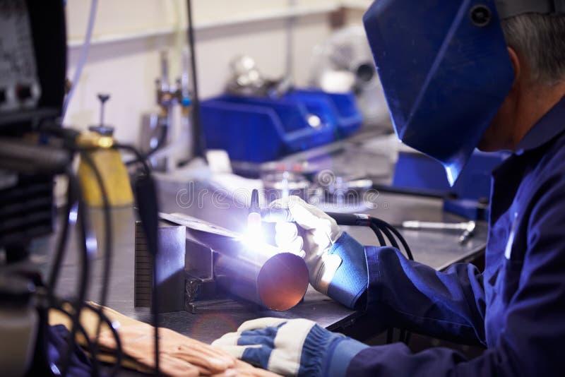 Factory Engineer Operating TIG Welding Machine stock photo