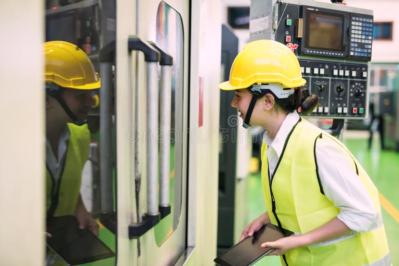 Factory female worker inspect machine royalty free stock photo