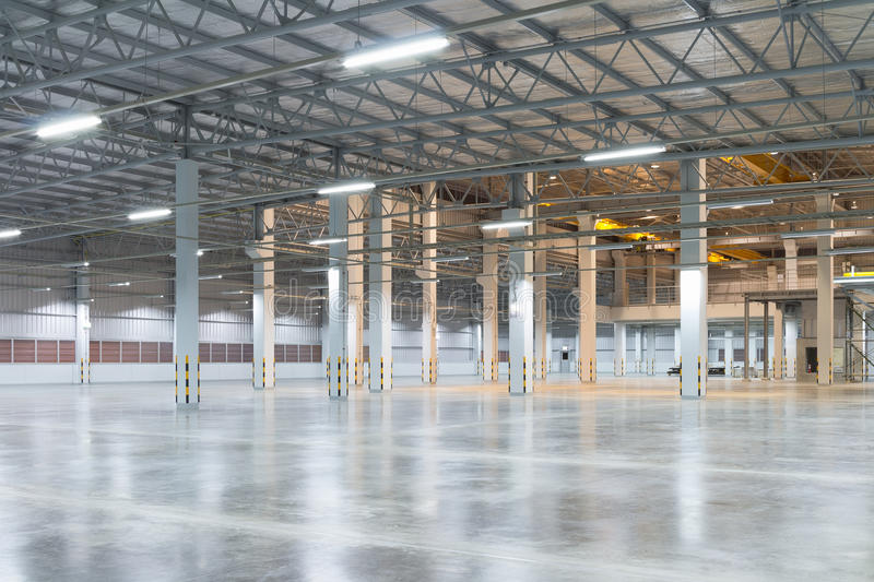 Factory floor background. Empty factory building or warehouse building with concrete floor for industry background royalty free stock photography