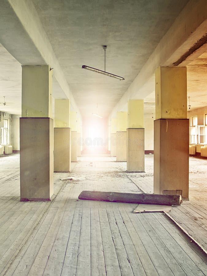 Factory floor. Floor bathed in sunlight in an abandoned industrial complex stock image