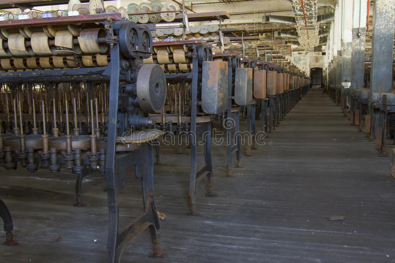 Factory floor of silk mill. Factory floor of turn of the century silk throwing factory stock photography