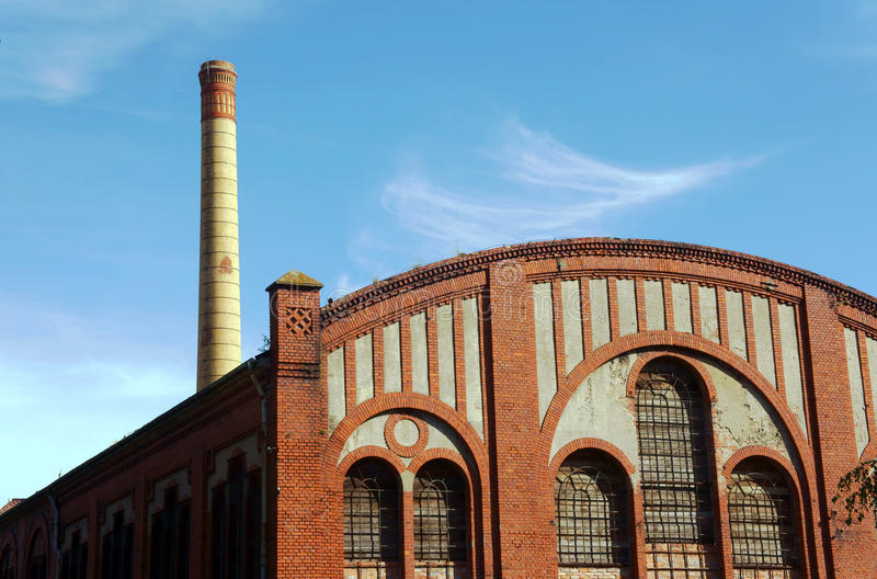 Factory floor and smokestack in old gasworks. Poznan, Poland stock image