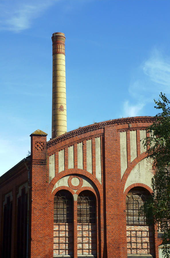 Factory floor and smokestack in old gasworks. Poznan, Poland royalty free stock photo