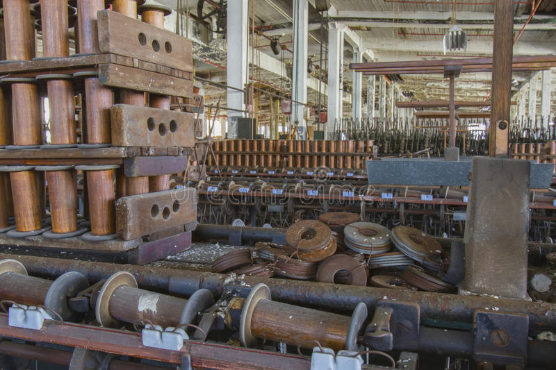 Factory floor of thread mill. Aging equipment on floor of abandoned turn of the century silk throwing factory stock images