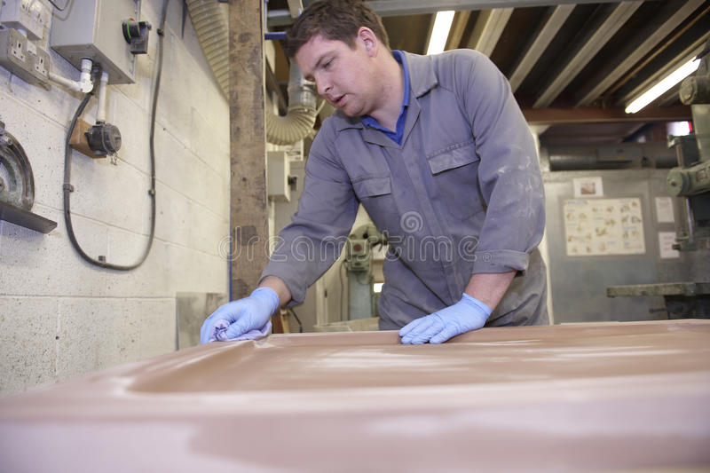 Factory floor worker. Senior worker on factory floor in the manufacturing industry royalty free stock photos