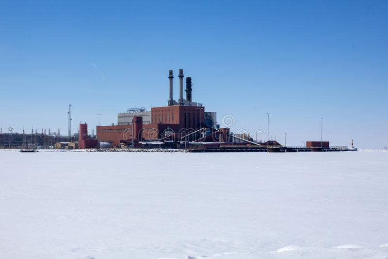 Factory by frozen lake Lake Erie royalty free stock photos
