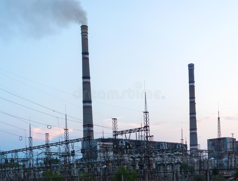 Factory Generating coal power plant at sunset. Environmental pollution carbon dioxide royalty free stock photo