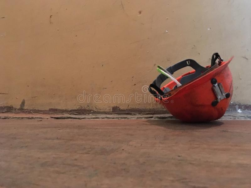 Factory helmet. Industrial safety helmet laying on the floor stock photo