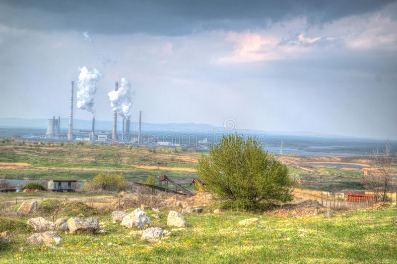 Summer landscape. Factory pollutes stock images