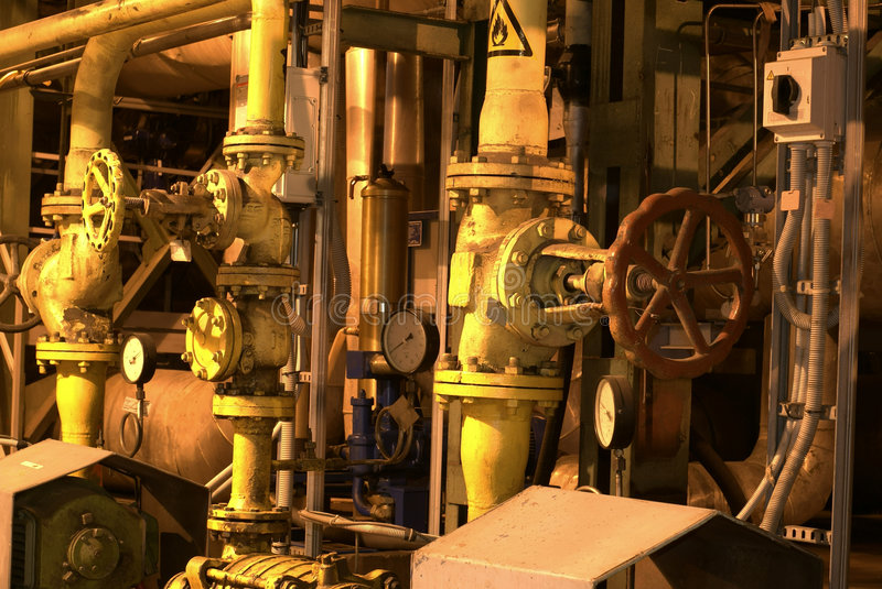 Factory machines and piping royalty free stock photo